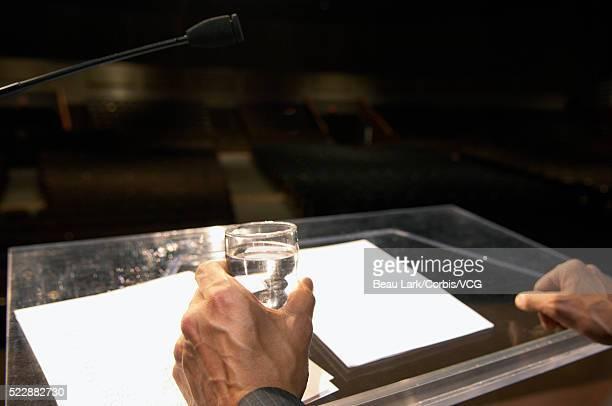 Speaker standing behind lectern