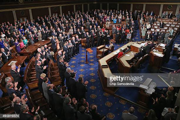 Speakerelect of the House Paul Ryan delivers remarks before being sworn in on the floor of the House chamber at the US Capitol October 29 2015 in...