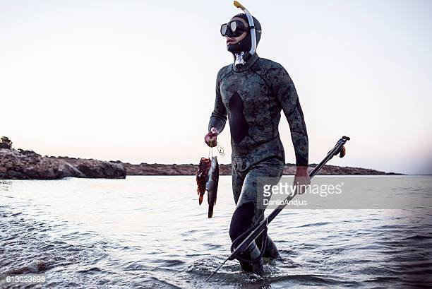 spear fisherman coming back from the sea
