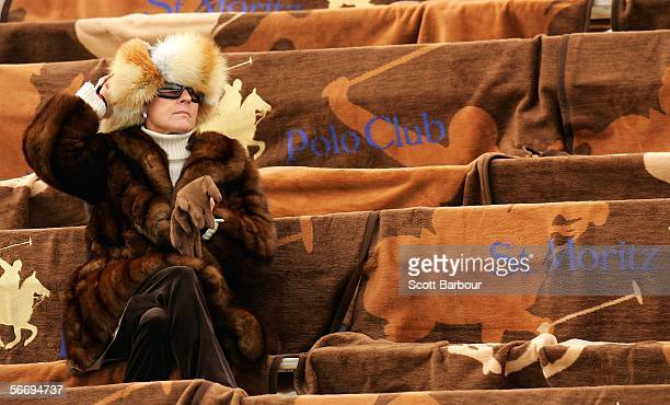 A specator watches a match during the 22nd Cartier Polo World Cup on Snow on January 28 2006 in St Moritz Switzerland The matches are being held on...