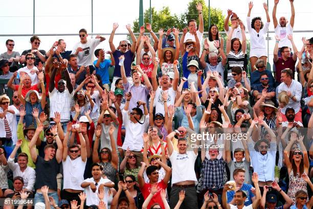 Specators enjoy the atmosphere during the Gentlemen's Singles fourth round match between Tomas Berdych of The Czech Republic and Dominic Thiem of...
