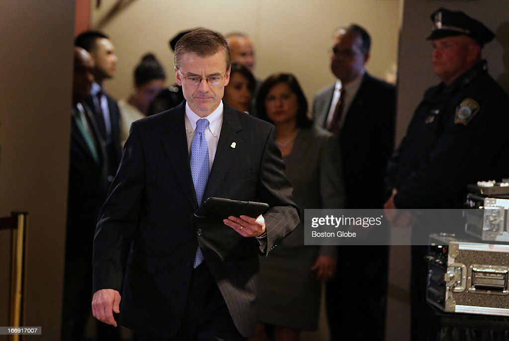 Special Agent in Charge of the FBI's Boston Field Office Richard DesLauriers enters for today's press briefing where photos of two suspects in the Boston Marathon bombing investigation were released. United States Attorney Carmen Ortiz, and FBI JTTF law enforcement partners were also present.