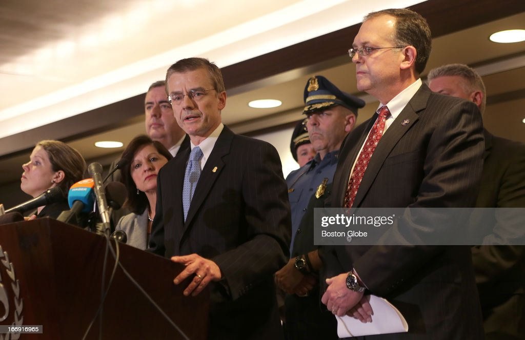 Special Agent in Charge of the FBI's Boston Field Office Richard DesLauriers, center with glasses, addresses the media during today's press conference where photos of two persons of interest in the Boston Marathon bombing investigation were unveiled. Also appearing were BPD Commissioner Ed Davis, United States Attorney Carmen Ortiz, and FBI JTTF law enforcement partners.