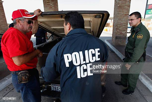 Special agents from Immigration and Customs Enforcement Border Patrol and Customs and Border Protection question a man while his vehicle is searched...