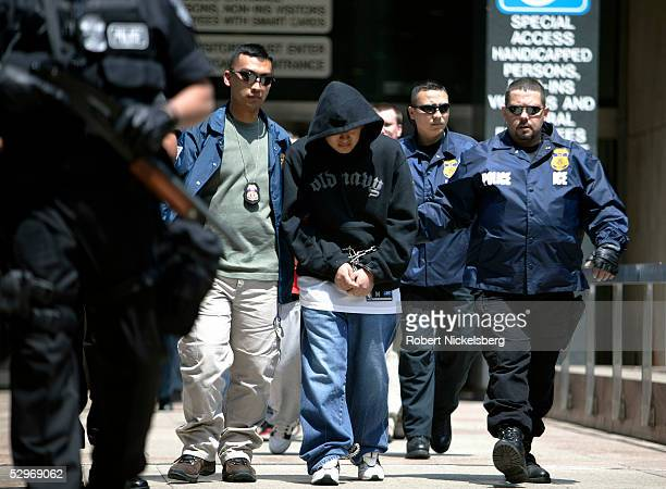 Special agents working for Immigration and Customs Enforcement escort members of a Mexican gang to court following their arrests May 11 2005 in New...
