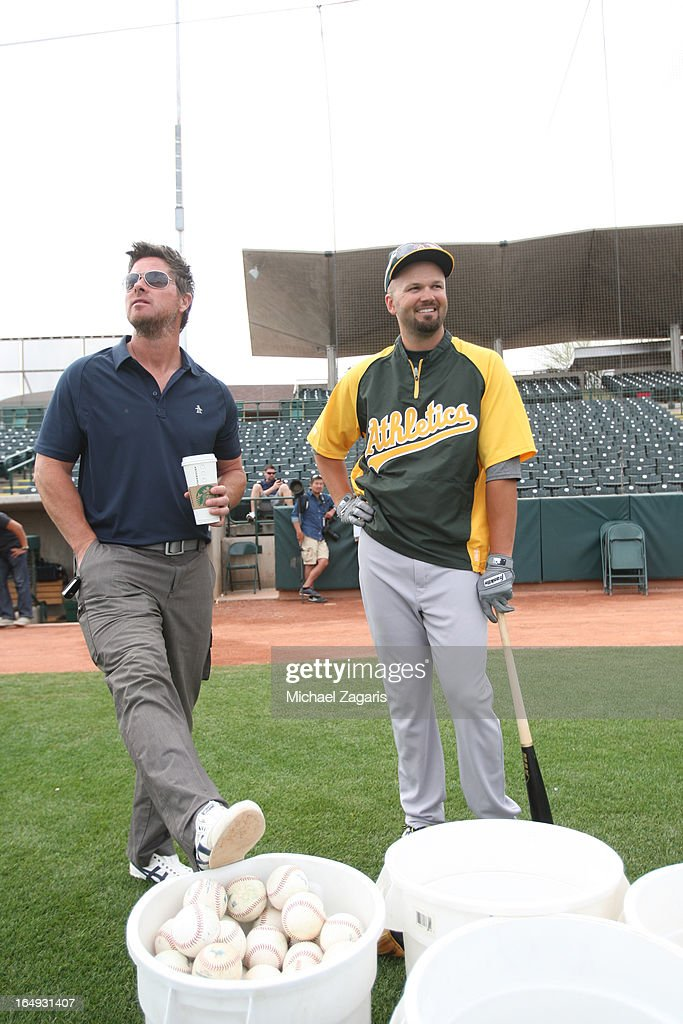 Special Assistant to Baseball Operations <a gi-track='captionPersonalityLinkClicked' href=/galleries/search?phrase=Scott+Hatteberg&family=editorial&specificpeople=239531 ng-click='$event.stopPropagation()'>Scott Hatteberg</a> of the Oakland Athletics stands on the field with Scott Moore #18 during a spring training workout at Phoenix Municipal Stadium on March 3, 2013 in Phoenix, Arizona.