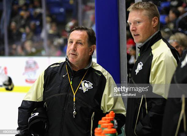 Special Assistant to the Head Coach Jacques Martin and Head Athletic Trainer Chris Stewart of the Pittsburgh Penguins watch practice for the NHL...