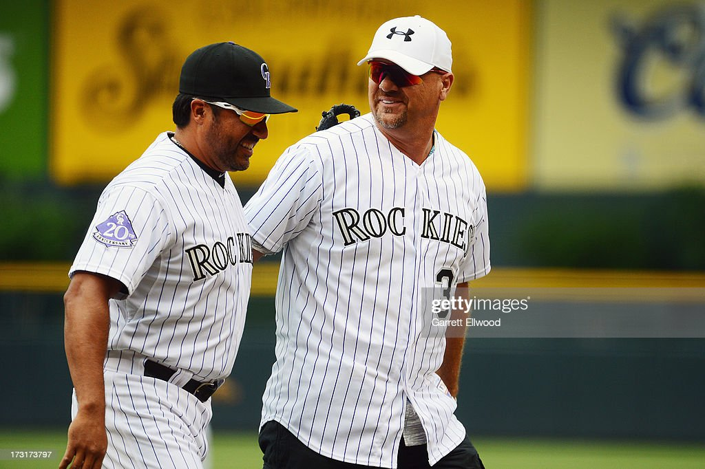 Special Assistant Vinny Castilla and former Colorado Rockies player Larry Walker share a laugh after the ceremonial first pitch prior to the game...