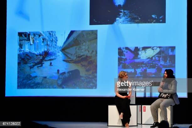 'Special Award' Winner 2016 Hosam Katan and Caren Miosga speak on stage at the Nannen Award 2017 on April 27 2017 in Hamburg Germany