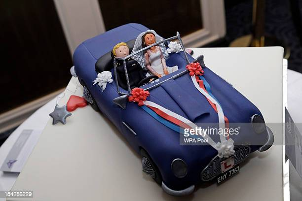 A special cake reenacting the scene of Prince William Duke of Cambridge's wedding in 2011 where he drove the car with his wife the Catherine Duchess...