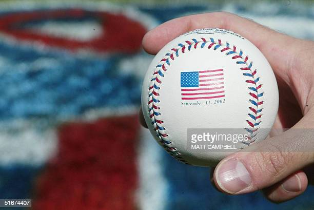 A special ceremonial first pitch baseball design featuring an American flag and red and blue lacings to honor the one year anniversary of the...