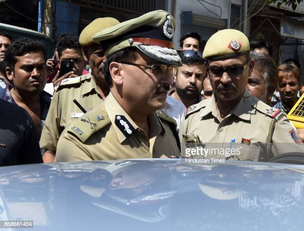 Special Commissioner Law Order North Delhi Police SBK Singh at Jindal house after five persons including four women of a family were found stabbed to...