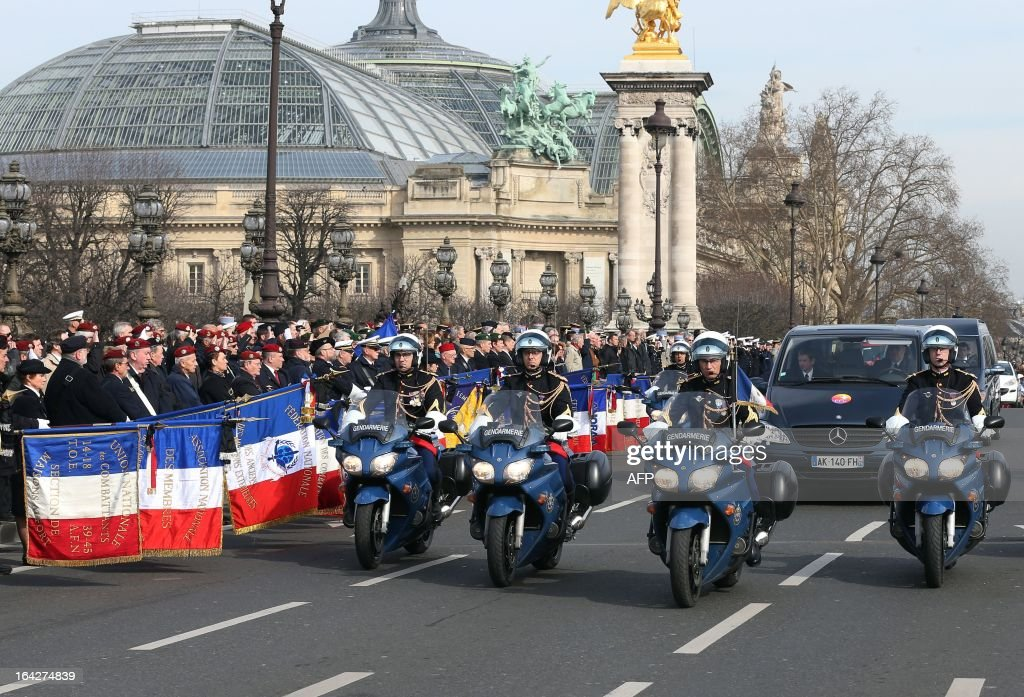 A special convoy carrying the body of late French soldier Alexandre Van Dooren, 24, drives on the Pont Alexandre III bridge on March 22, 2013 in Paris, ahead of an official ceremony. The soldier from Angouleme's marine infantry regiment, was killed on March 16, 2013 during fighting in northern Mali, bringing to five the number of French deaths since the January 11 intervention to oust armed Islamist groups.