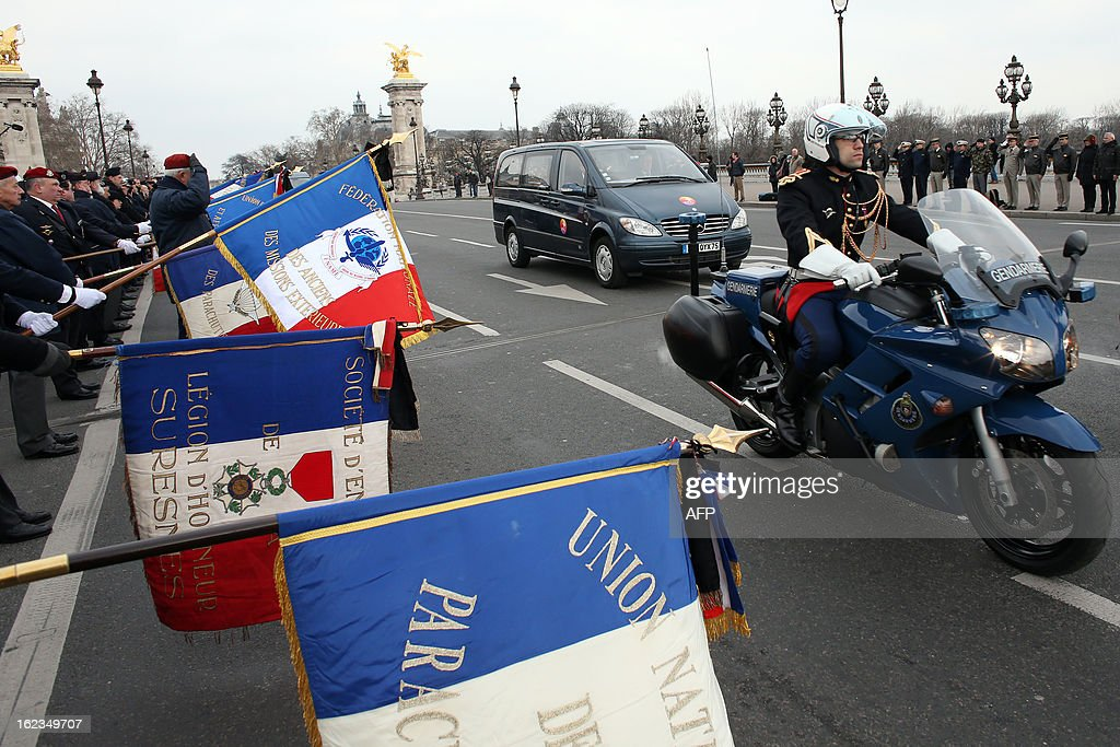 A special convoy carrying the body of late French Staff Sergeant Harold Vormezeele drive on the Pont Alexandre III bridge on February 22, 2013 in Paris, ahead of an official ceremony. Vormezeele, an NCO and commando with the 2nd Foreign Parachute Regiment, an elite unit of the French Foreign Legion, was killed on February 19 during an operation in northern Mali against Islamist rebels. He was the second French soldier killed since the start of France's military intervention in Mali on January 11.