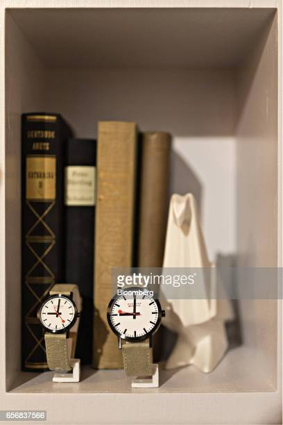 Special edition Classic official Swiss Railways model wristwatches produced by Mondaine Watch Ltd stand on display on a bookcase shelf at the...