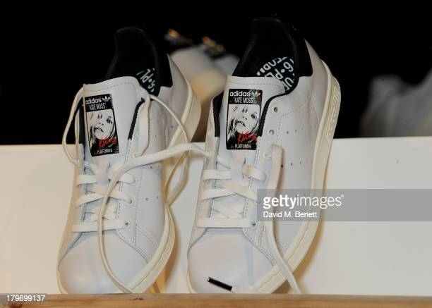 Special edition Kate Moss x Platform 6 adidas Originals Stan Smith trainers are displayed at a private view of the Platform Six exhibition with...