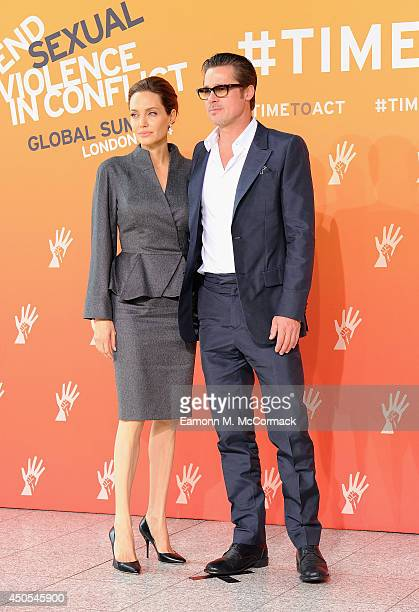 Special Envoy and actress Angelina Jolie and Actor Brad Pitt attend the Global Summit to End Sexual Violence in Conflict at ExCel on June 13 2014 in...