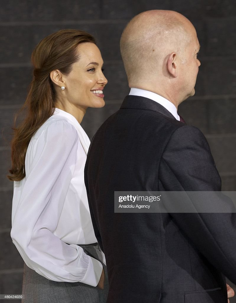 UN Special Envoy and actress Angelina Jolie and British Foreign Secretary William Hague (R) attend the Global Summit To End Sexual Violence In Conflict on June 11, 2014 in London, England. The four-day conference on sexual violence in war is hosted by Foreign Secretary William Hague and UN Special Envoy and actress Angelina Jolie.