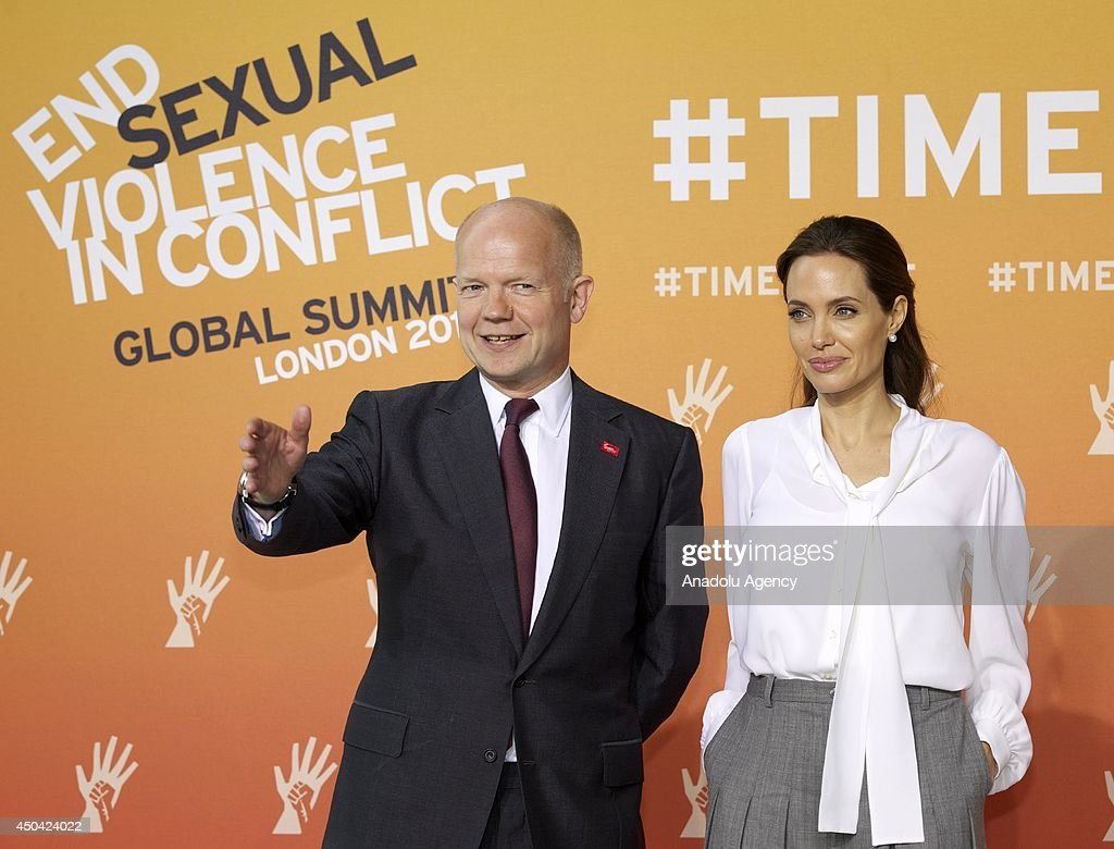 UN Special Envoy and actress <a gi-track='captionPersonalityLinkClicked' href=/galleries/search?phrase=Angelina+Jolie&family=editorial&specificpeople=201591 ng-click='$event.stopPropagation()'>Angelina Jolie</a> and British Foreign Secretary <a gi-track='captionPersonalityLinkClicked' href=/galleries/search?phrase=William+Hague&family=editorial&specificpeople=206295 ng-click='$event.stopPropagation()'>William Hague</a> (L) attend the Global Summit To End Sexual Violence In Conflict on June 11, 2014 in London, England. The four-day conference on sexual violence in war is hosted by Foreign Secretary <a gi-track='captionPersonalityLinkClicked' href=/galleries/search?phrase=William+Hague&family=editorial&specificpeople=206295 ng-click='$event.stopPropagation()'>William Hague</a> and UN Special Envoy and actress <a gi-track='captionPersonalityLinkClicked' href=/galleries/search?phrase=Angelina+Jolie&family=editorial&specificpeople=201591 ng-click='$event.stopPropagation()'>Angelina Jolie</a>.