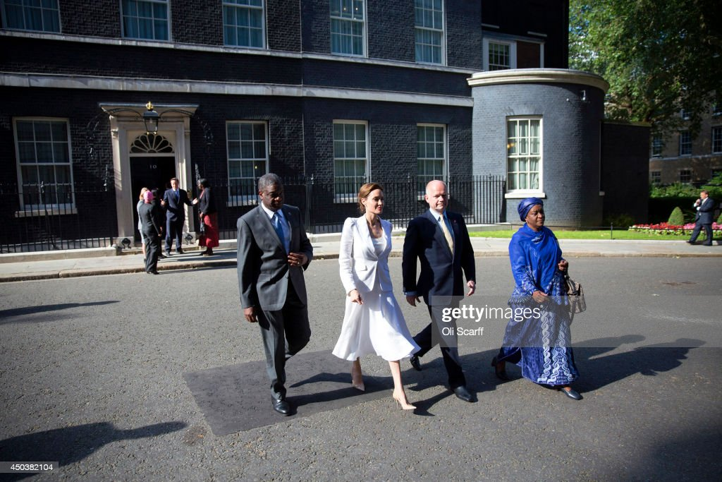 UN Special Envoy and actress Angelina Jolie (3rd R) and Foreign Secretary William Hague (2nd R) leave Number 10 Downing Street after having attended the Global Summit To End Sexual Violence In Conflict at the ExCeL centre on June 10, 2014 in London, England. The four-day conference on sexual violence in war is hosted by Foreign Secretary William Hague and UN Special Envoy and actress Angelina Jolie.