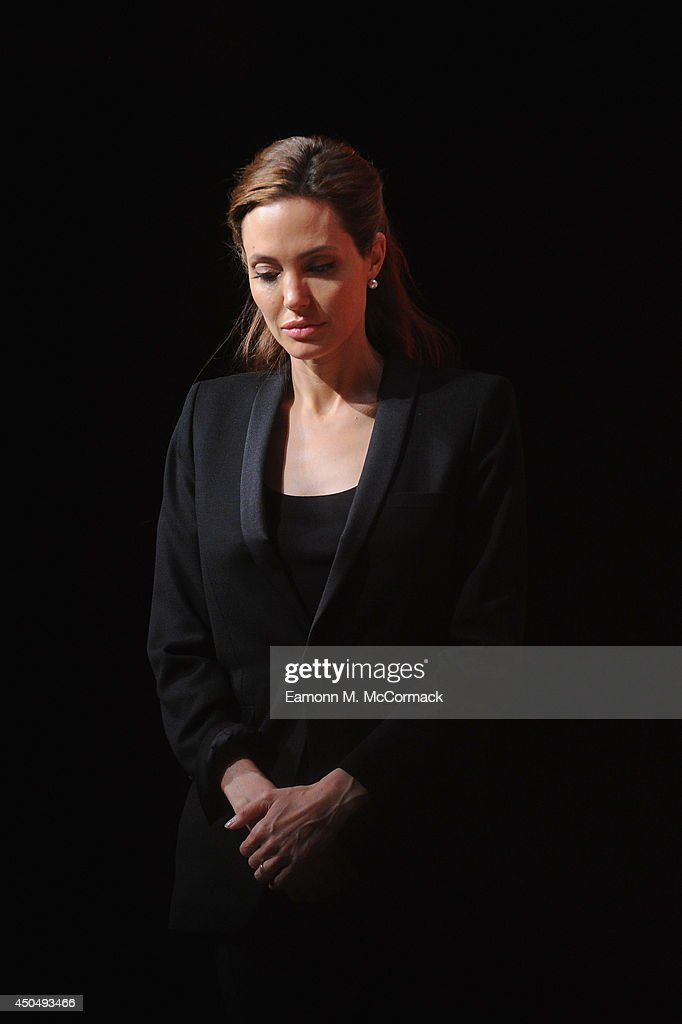 UN Special Envoy and actress <a gi-track='captionPersonalityLinkClicked' href=/galleries/search?phrase=Angelina+Jolie&family=editorial&specificpeople=201591 ng-click='$event.stopPropagation()'>Angelina Jolie</a> pauses in moment of silence at the Global Summit to End Sexual Violence in Conflict at ExCel on June 12, 2014 in London, England. The four-day conference on sexual violence in war is hosted by Foreign Secretary William Hague and UN Special Envoy and actress <a gi-track='captionPersonalityLinkClicked' href=/galleries/search?phrase=Angelina+Jolie&family=editorial&specificpeople=201591 ng-click='$event.stopPropagation()'>Angelina Jolie</a>.