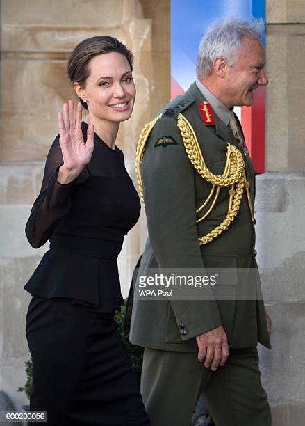 Special Envoy Angelina Jolie is greeted by UK Vice Chief of the Defence Staff General Sir Gordon Messenger at the UN Peacekeeping Defence Ministerial...