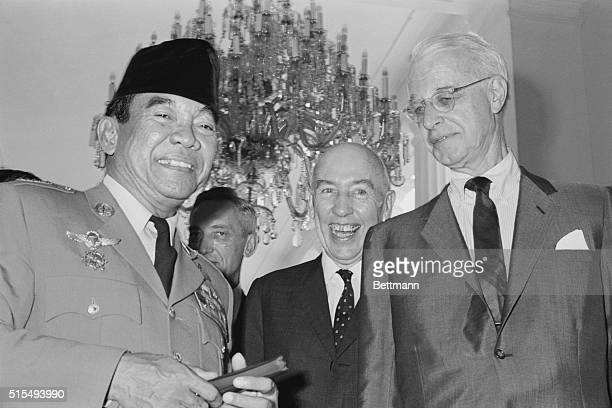 US Special Envoy Ellsworth Bunker right and Ambassador Howard P Jones center chatting with Indonesian President Sukarno April 6 at the Presidential...