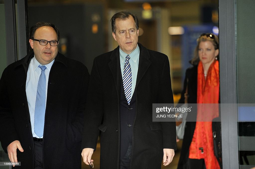 US special envoy for North Korea policy Glyn Davies (C) arrives at Incheon international airport, west of Seoul, on January 23, 2013 for talks on North Korea. The UN Security Council ordered expanded sanctions on January 22, against North Korea for a banned rocket launch, triggering a defiant pledge by Pyongyang to bolster its nuclear deterrent.