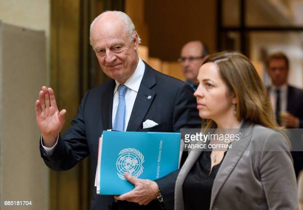 UN Special Envoy for Syria Staffan de Mistura gestures upon his arrival for a meeting with Syria's main opposition High Negotiations Committee during...