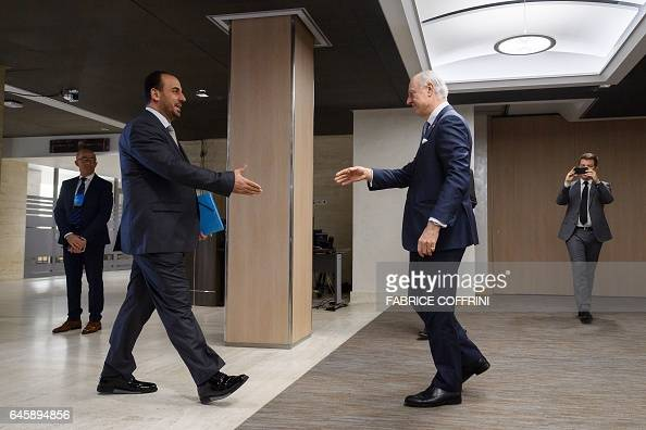 UN Special Envoy for Syria Staffan de Mistura shakes hands to Syria's main opposition High Negotiations Committee leader Nasr alHariri upon his...