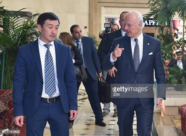 UN Special Envoy for Syria Staffan de Mistura speaks to an official as he attends the fourth round of Syria peace talks in Astana on May 3 2017 / AFP...