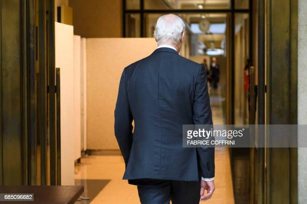 UN Special Envoy for Syria Staffan de Mistura walks prior to a meeting with members of the Syrian government delegation during peace talks on May 19...
