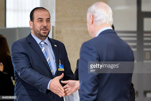 UN Special Envoy of the SecretaryGeneral for Syria Staffan de Mistura shakes hand with Syria's main opposition High Negotiations Committee leader...