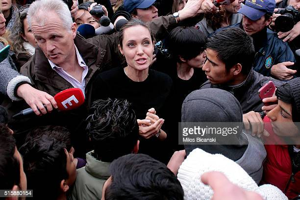 Special envoy of the United Nations High Commissioner for Refugees Angelina Jolie talks to young migrants during her visit to the temporary refugee...