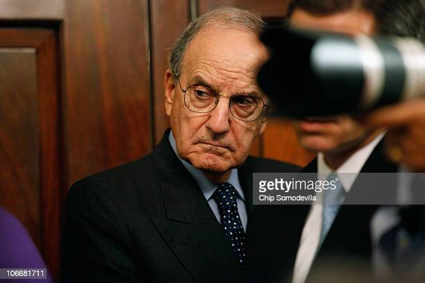 S Special Envoy to the Middle East George Mitchell stands with officials and reporters in the Treaty Room during a news briefing with US Secretary of...
