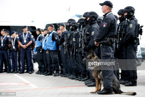A special federal police unit stands on display during a visit by German Interior Minister Thomas de Maiziere at the fair halls of the G20 summit...