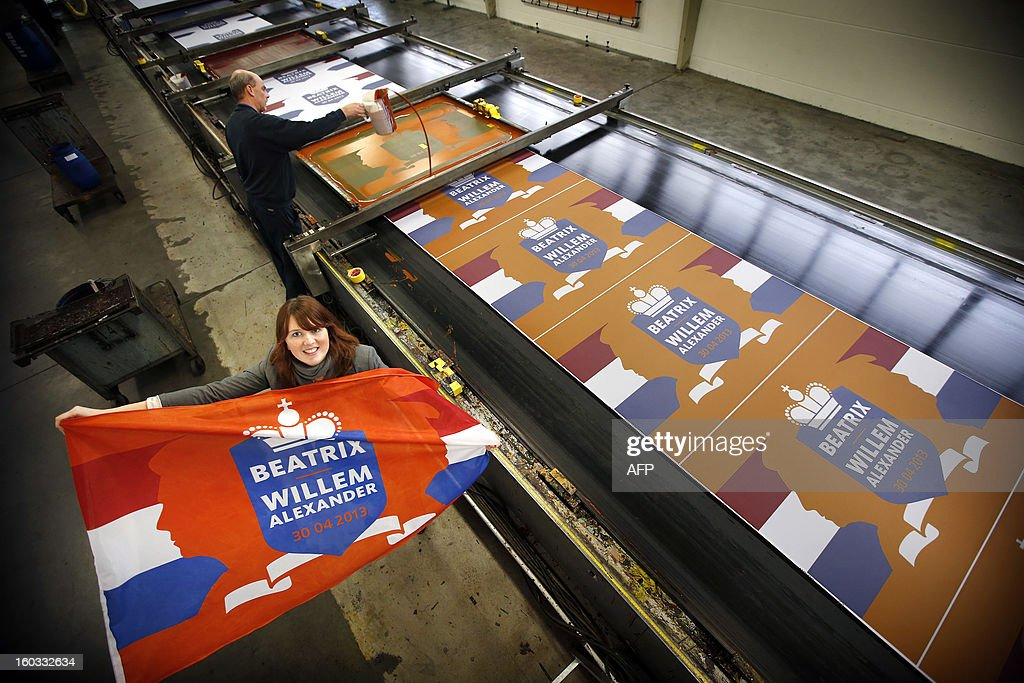 A special flag for Queen Beatrix and Prince Willem-Alexander is produced at the Dokkumer Vlaggen Centrale in Dokkum, The Netherlands, on January 29, 2013. The Queen announced yesterday her abdication which will make the Prince successor to the throne. AFP PHOTO/ CATRINUS VAN DER VEEN netherlands out