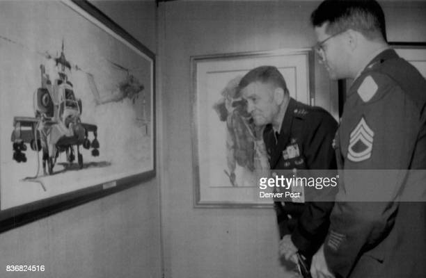 John Epperson Lt Gen Ellis Parker director of the Army staff center look at a painting by SFC Peter G Varisano called 'Desert Storm 101st Style' at...