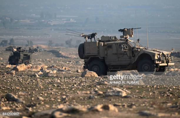US special forces monitor as Iraqi forces advance on February 23 2017 towards Mosul airport on the southern edge of the jihadist stronghold prior to...