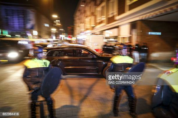 Special forces of the Dutch Police 'Dienst Speciale Interventies' arrive at the Schiedamse Vesthof where the Turkish Family Minister Fatma Betul...