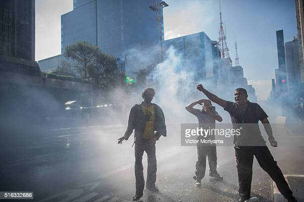 Special Forces police use water cannon to clear the Avenida Paulista the main avenue of the city of Sao Paulo where protesters demonstrate against...