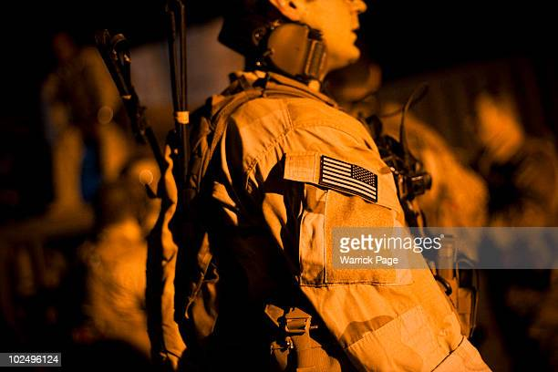 Special Forces prepare to accompany Iraqi Emergency Response Brigades on a night mission to serve an arrest warrant on a suspected insurgent...