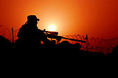 Rawah, Iraq, September 7, 2007 ‰ÛÒ A U.S. Special Forces soldier conducts rehearsal, training and pre-operation conformation on the MK-12 sniper rifle at sunset.