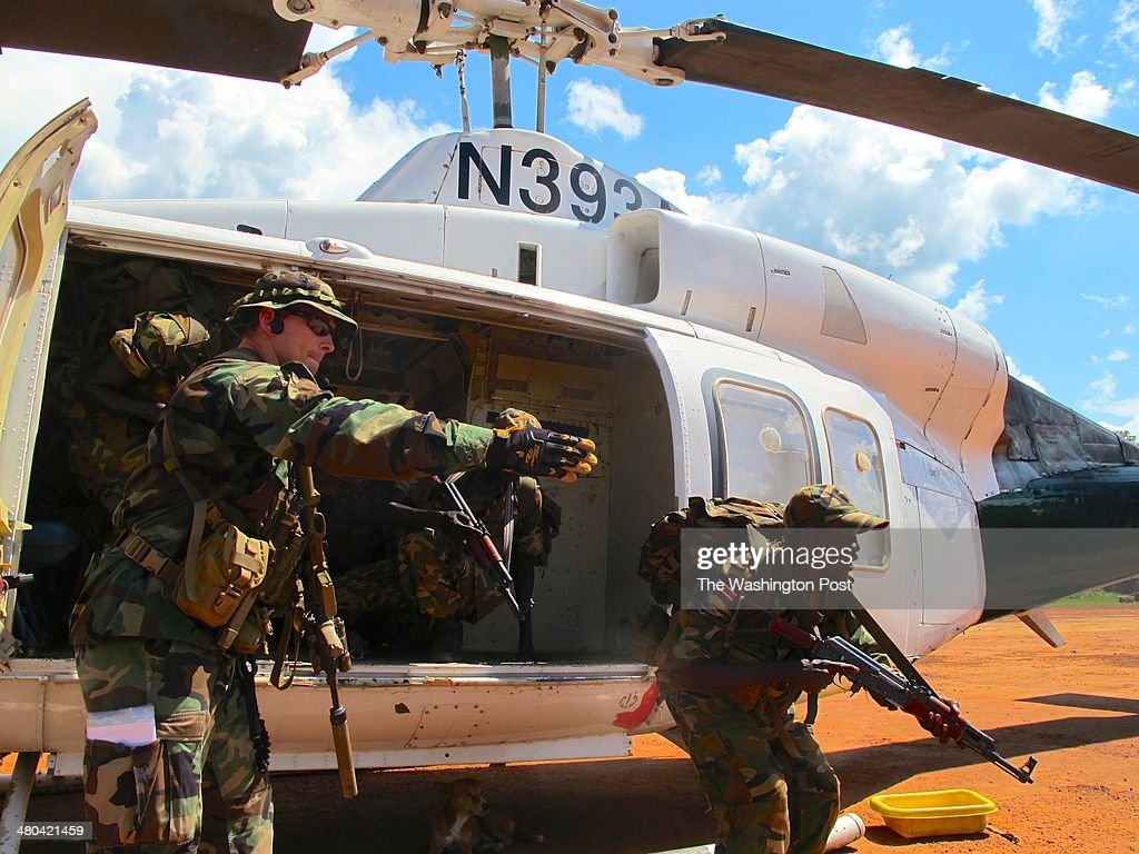 A U.S. Special Forces soldier instructs South Sudanese commandos on how to quickly exit a helicopter at a U.S.-run base in Nzara, South Sudan.