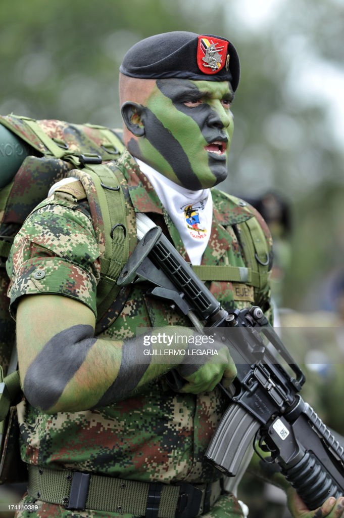 A special forces soldier parades during the celebrations for the 203rd Anniversary of the Independence of Colombia, in Bogota, Colombia, on July 20, 2013. AFP PHOTO/ Guillermo LEGARIA