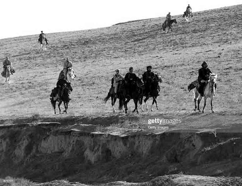 US special forces soldiers ride on horseback as they work with members of the Northern Alliance in Afghanistan during Operation Enduring Freedom in...