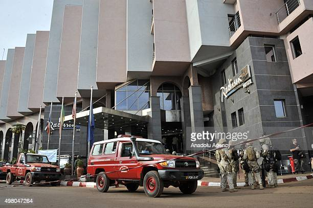 Special forces take security measurements outside the Radisson Blu hotel in Bamako on November 20 2015 Gunmen have taken 170 hostages and at least 20...