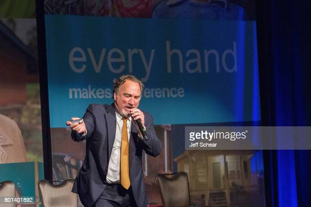 Special guest and DuPage native Jim Belushi gives a soulful performance of 'Sweet Home Chicago' to close out the Habitat Hero Award Dinner held June...