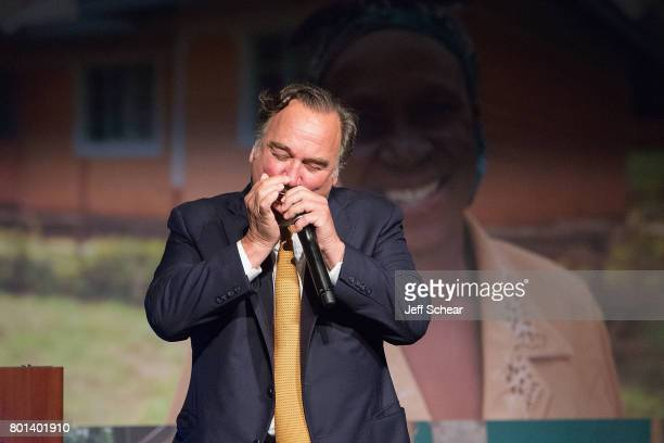 Special guest and DuPage native Jim Belushi gives a soulful performance of 'Sweet Home ChicagoÓ to close out the Habitat Hero Award Dinner held June...