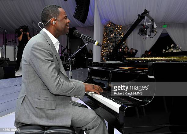 Special guest Brian McKnight performs during the wedding of Michaele Schon and Neal Schon at the Palace of Fine Arts on December 15 2013 in San...
